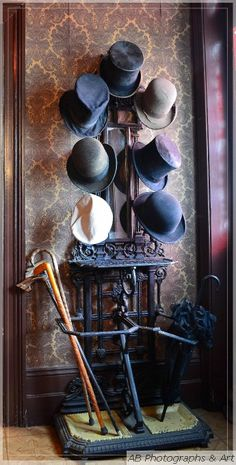 For a Victorian inspired living room--hat, cane, and parasol display!