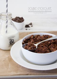 Double Chocolate, Almond, and Coconut Granola - a perfectly crunchy granola filled with chocolate-y clumps of oats, almonds, and coconut flakes, with chunks of dark chocolate in every bite. Confessions of a Bright-Eyed Baker.
