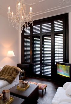 Black plantation shutters. Nice! Woonkamer - Jasno lShutters & Blinds I would add a plant :)