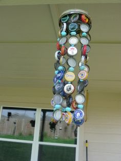 Bottle cap wind chime - Maybe you could use buttons if you don't have bottle caps. A metal embroidery hoop would work for the top.