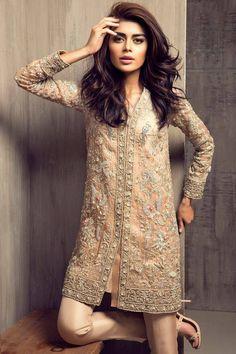 Short embellished kurta over cigarette trousers