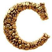 Alfabeto de los granos de café de oro. aislado en blanco. stock photography