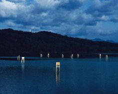 fragile chairs invade japanese lake by hidemi nishida