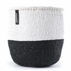 Mifuko Small Black and White Kiondo Basket : These beautiful and functional Kiondo baskets are also environmentally sustainable and ethically produced.  They are hand woven by women in Kenya using sisal and food grade plastics that are 80% recycled. Kiondos are produced following the principles of Fair Trade and help bring secure incomes and fair working conditions to Kenyan artisans.