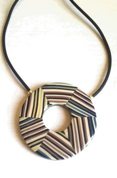 Helios pendant | polymer clay | florence Belliard | Flickr