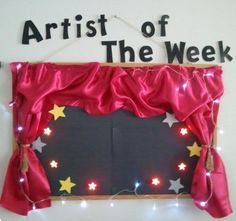 Great idea for music; I have one that I made, except it's the Artist of the Month instead.  I love the curtain and the stars!