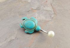 Hey, I found this really awesome Etsy listing at http://www.etsy.com/listing/152740810/turquoise-turtle-belly-button-ring-pearl