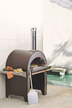 By combining old-world methods with the latest manufacturing technology, the Alfa Forno 4 Wood Burning Pizza Oven can bake wood-fired pizzas and grill or broil your favorite meats and vegetables - all at the same time. | Frontgate: Live Beautifully Outdoors