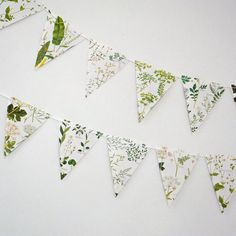 This lovely bunting with leaves, grasses and plants has been up-cycled from a book about British wild flowers. This bunting is gorgeous wedding decor and lovely to hang in any room in your home to bring a little of the outside in! It is perfect if you want an outdoors feeling without too much colour! There are 8 triangular flags, each approximately 20.5 cm long x 17 cm across (approx. 8 in x 6.5 in). The bunting is designed to be viewed from one side (although there are pictures on both…