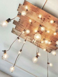 Light bulbs on a wood plank