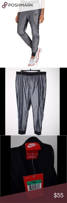 NWT Nike Windbreaker Jogger Cuffed Pants XL New with tags Womens Nike windbreaker cuffed pants. Size XL. Perfect for exercising in the colder months! Great style! Nike Pants Track Pants & Joggers