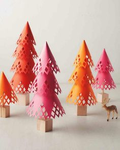 For a fun Christmas craft, make these pretty paper trees.