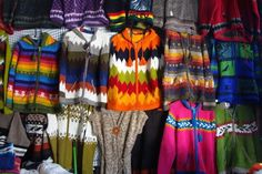 Colourful wool garments and handicrafts at Angelmó market, Puerto Montt, Chile.