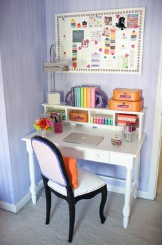 Little girls room. Those books, wall paint/wash treatment, push-pins.