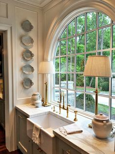 IMAGINE HAVING A HUGE WINDOW LIKE THIS IN THE KITCHEN!! - SUCH A FOCAL POINT WITH ITS' CURVED TOP & FRENCH PANES!! - JUST A BEAUTIFUL KITCHEN, INCLUDING THE SINK!! ;)