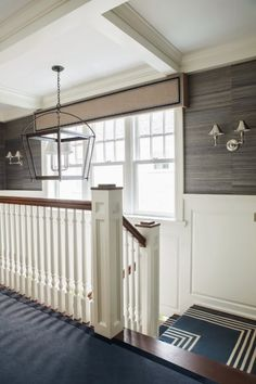 white and wood stairs, lantern light, white trim, Navy Blue