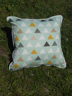 A personal favorite from my Etsy shop https://www.etsy.com/listing/235805811/triangle-pillow-green-and-multicolor