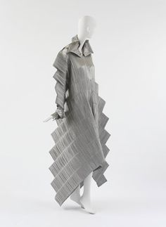 """Issey Miyake (Japanese, b. 1938). """"Staircase Pleats"""" Dress, fall/winter 1994–95. Silver pleated polyester."""