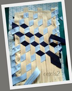 how to make tumbling block quilt by weaving strips of fabric