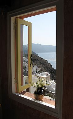 Coffee shop window with view over the caldera by Shelley & Dave, via Flickr