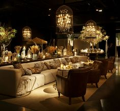 Cages, chandeliers and animlas print, wild decoration with leather armchair ans lots of flowers and branches.