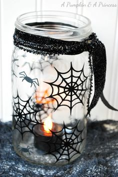 Love this spiderweb mason jar lantern
