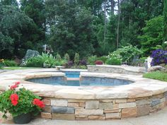 Waterline tile and blue in spa face stone. Gardens South Landscape and Design, Inc., Athens, Georgia Landscaping - Gardens South Landscape and Design, Inc., Athens, GA Landscaper