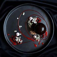 [elderflower] by @lvin1stbite ・・・ Dark chocolate mousse sphere, cherry compote, hazelnut dacquoise, meringue and elderflower.