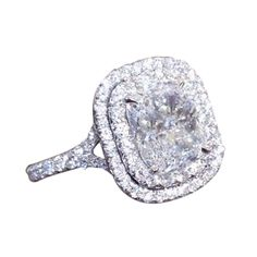 Unique Cushion Cut Double Halo Engagement Ring | From a unique collection of vintage engagement rings at https://www.1stdibs.com/jewelry/rings/engagement-rings/