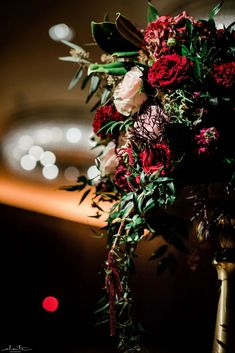 Red roses, antique hydrangea, stock, blush roses and lots of texture and foliages make a memorable tall winter floral arrangement at a ballroom wedding reception. Ballroom Wedding Reception, Wedding Reception Flowers, Winter Wedding Flowers, Floral Wedding, Tall Wedding Centerpieces, Tall Centerpiece, Floral Centerpieces, Winter Floral Arrangements, Wedding Flower Arrangements