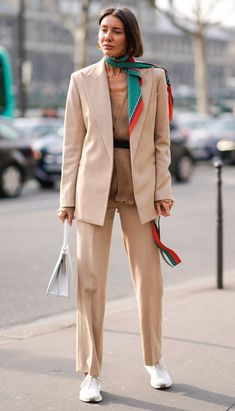 Learn how to wear a trouser suit like the street style set and see our guide to the best suits to buy now.
