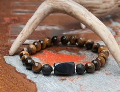 Mens Tigers Eye, Agate, and Lave Bracelet. This piece of man glitter can be dressed up or worn on a casual day. Available now on my etsy shop. Check out all our jewelry.    Check out this item in my Etsy shop https://www.etsy.com/listing/268080799/tigers-eye-and-lava-mens-bracelet-gift