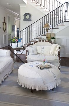 Ottoman with a linen ruffled slipcover and casters from Cedar Hill Farmhouse.