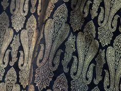 Brocade Fabric, Indian brocade, Banaras silk, Silk Brocade Fabric. This is a beautiful pure heavy benarse silk brocade fabric in black and gold. The fabric illustrate golden woven damask pattern on...