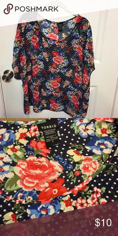 Floral sheer poncho Navy and white polka dots with floral sheer poncho. This can be worn with many color options and can be dressed up or dressed down. Size 2 (plus). Price is negotiable. Make offer. Torrid Tops Blouses
