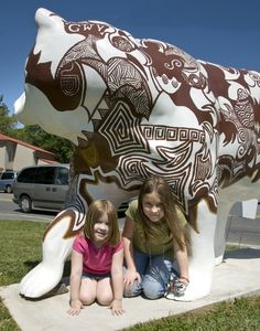 """Downtown Cherokee, NC is """"alive"""" with colorfully painted fiberglass bears that are part of a public art program featuring the talents of local Tribal artists. Each one of the bears represents an aspect of Cherokee culture. Photo by Charles Snodgrass"""