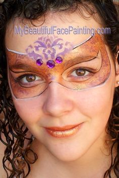 Mardi Gras face painting mask in gold and purple.