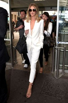 Rosie Huntington-Whiteley in a suit by Magda Butrym paired with neutral sandals