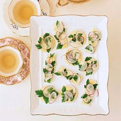 These open-faced sandwiches created by F&W's Marcia Kiesel can be cut into whimsical shapes. For a little graphic fun, look for radishes of varying shapes and sizes.