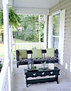 Front Porch Makeover {Reveal} - Love the idea of a swing out of an old headboard!