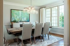 https://www.transformingrooms.com, abstract art, a unique chandelier, and gray dining table