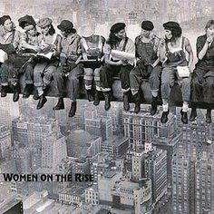 "Women on the Rise -- A remake of Charles C. Ebbets famous photo, ""Lunch Atop a Skyscraper""."