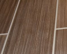 KITCHEN TILE IDEA: Wood-plank tile for kitchen. Black walnut tile available at Lowes. Only $2.48 per sq ft! Power Grout light pewter makes grains in wood pop.