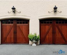 Decorative lighting above faux wood garage doors completes the carriage house look, beautifully.  Also notice the arched glass garage door windows, decorative hardware and door panels with a walnut finish. | Pro-Lift Garage Doors on Houzz |  Photo Credits: Pro-Lift Garage Doors Va