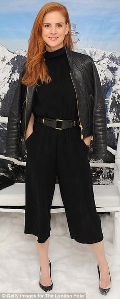 Suits you: Actress Sarah Rafferty showed off her black jumpsuit and heels...