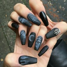 Black matte and glossy nails with goth decoration