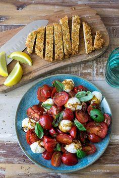 Rezept für leckeres Parmesanschnitzel mit Tomatensalat