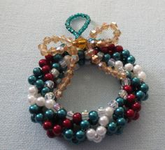 Bead and crystal snowflake / wreath by LescreationsAlepine on Etsy, $13.00 Snowflake Wreath, Ornament Wreath, Ornaments, Crystal Snowflakes, Bead Weaving, Wreaths, Beads, Crystals, Unique Jewelry