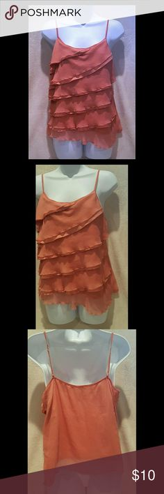 NY & CO Ruffled tank Layered ruffled tank with adjustable straps from New York & Company, size large. I would say the color of this tank I'd a blush pink, salmon color?! In EUC minus one small snag on the back, see pic #4 New York & Company Tops Tank Tops
