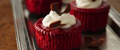 Looking for refrigerated dessert? Then check out these mini red velvet cheesecakes that are garnished with chocolate curls.